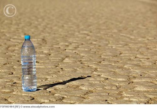 africa_namibia_namib_desert_water_bottle_on_dry_fof002404